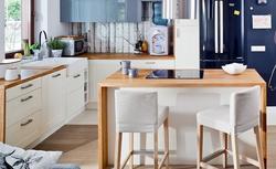 Wyspa kuchenna w kuchni otwartej i zamkniętej. Poznaj zasady i minimalne wymiary kuchni