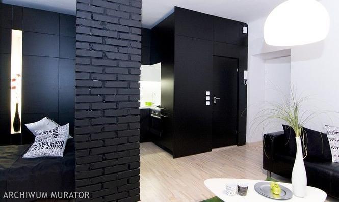 Czarna ściana w pokoju. Jak zastosować czarny kolor we wnętrzach?